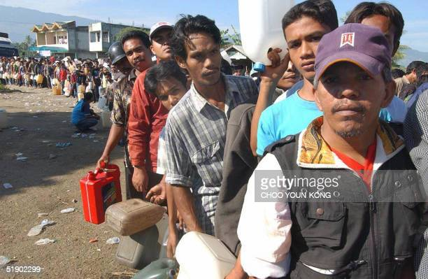 People wait to buy gasoline in a long line as people have been waiting for three days at a petrol station near Banda Aceh Indonesia 30 December 2004...