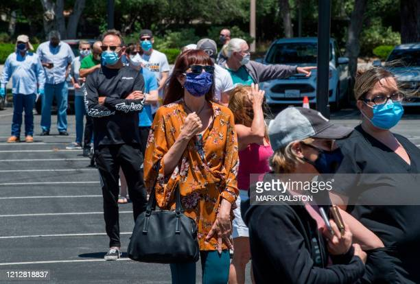 People wait to cast their votes at a polling station for the special election between Democratic state assembly woman Christy Smith and Republican...