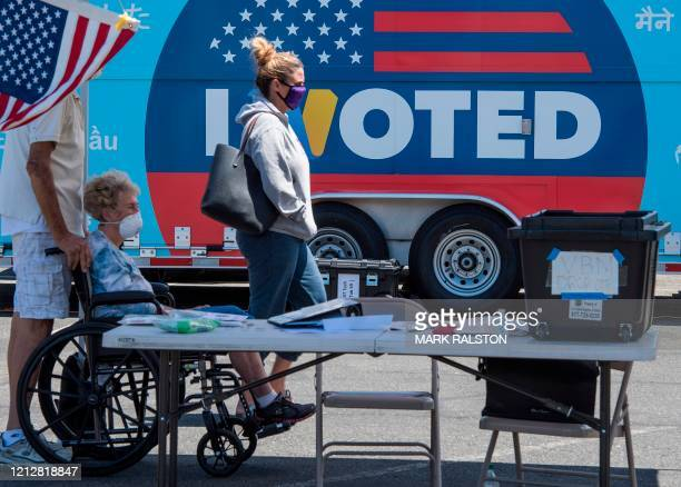 People wait to cast their votes at a polling station for the special election between Democratic state assemblywoman Christy Smith and Republican...