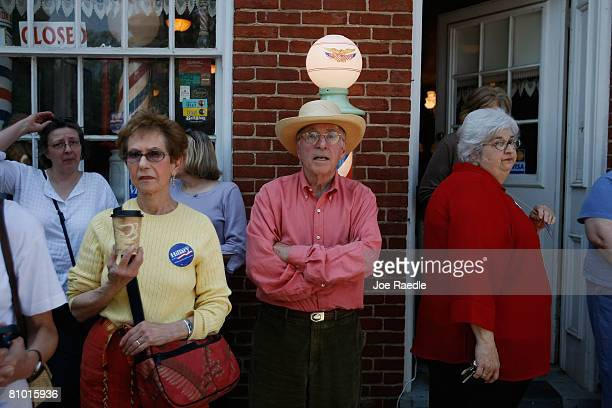 People wait to catch a glimpse of Democratic presidential hopeful US Senator Hillary Clinton during her campaign event at Shepherd University...