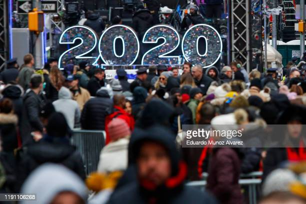 People wait to celebrate New Years eve in Times Square on December 31 2019 in New York City Because of the mild weather a larger than usual crowd of...