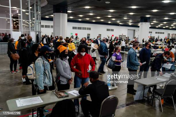 People wait to check into the Detroit Department of Elections Central Counting Board Voting at TCF Center, Wednesday, Nov. 4, 2020 in Detroit, MI....