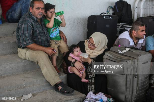 People wait to cross the Rafah Border with their luggages in Rafah Gaza on August 16 2017 Egypt decided to open Rafah Border Gate for only 2 days...