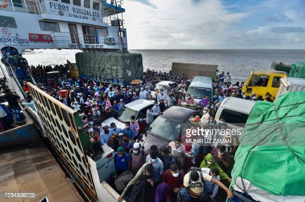 People wait to disembark from a ferry in Sreenagar on July 31, 2021 after they return to their work areas post the Bangladesh government relaxed the...