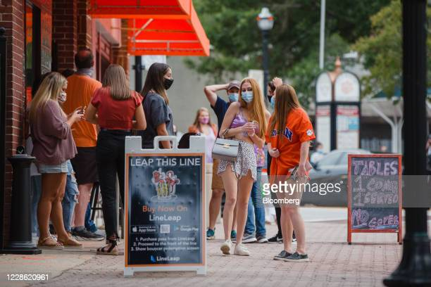 People wait to enter a bar on College Ave. During Clemson University's first home football game in Clemson, South Carolina, U.S., on Saturday, Sept....