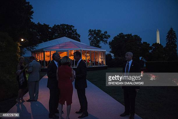 People wait to enter a tent for a dinner for participants of the US Africa Leaders Summit August 5 2014 in Washington DC AFP PHOTO/Brendan SMIALOWSKI