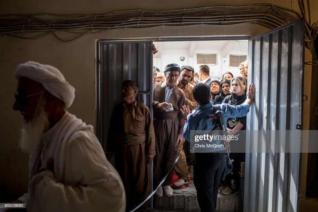 People wait to enter a voting station on September 25, 2017 in Erbil, Iraq. Despite strong objection from neighboring countries and the Iraqi government. Some five million Kurds took to the polls today across three provinces in the historic independence referendum.
