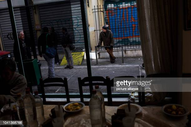 People wait to enter at a soup kitchen run by the Churchrun Galini charities near Athens Greece on March 6 2017 Photo Angelos Tzortzinis/dpa | usage...