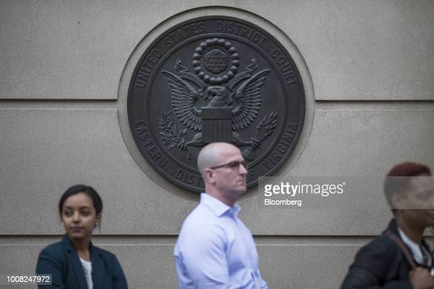 People wait to enter District Court before the trial of former Trump Campaign Manger Paul Manafort in Alexandria VA US on Tuesday July 31 2018 The...