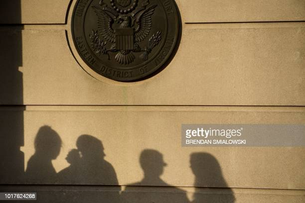 People wait to enter enter court before the jury deliberates in the trial of former Trump campaign manager Paul Manafort at the US District Court...