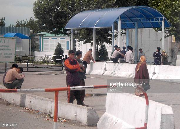 People wait to enter in Uzbekistan on the border crossing point near the town of Osh, southern Kyrgyzstan, 13 May 2005. Insurgents stormed key...