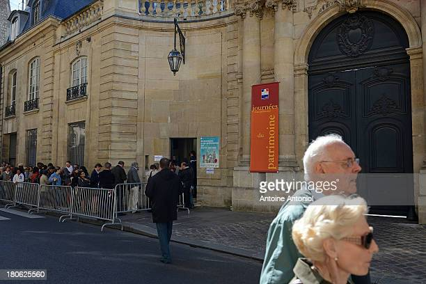 People wait to enter the Hotel Matignon during the 30th edition of France's European heritage days on September 15 2013 in Paris France Monuments and...