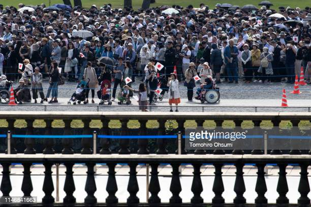 People wait to enter the Imperial Palace for Japan's Emperor Naruhito's first public appearance on May 04 2019 in Tokyo Japan Emperor Naruhito has...