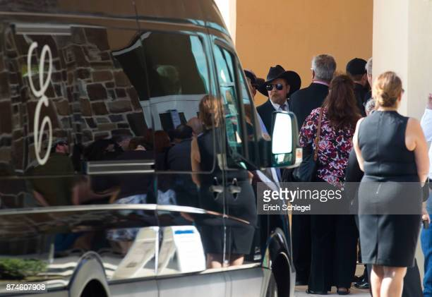 People wait to enter the memorial service held at the Floresville Events Center on November 15 2017 in Floresville Texas for the nine members of the...