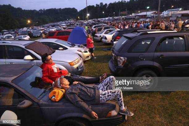 People wait to enter the Remote Area Medical mobile clinic after sleeping in their cars on July 21 2017 in Wise Virginia RAM holds the threeday event...