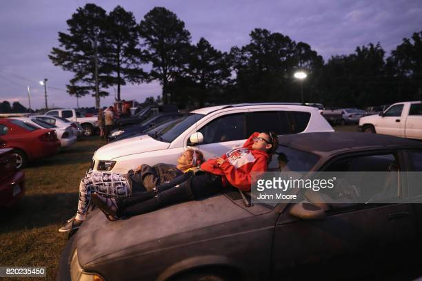 People wait to get healthcare services at the Remote Area Medical mobile clinic after sleeping in their cars on July 21 2017 in Wise Virginia RAM...