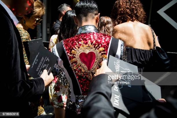People wait to get into the Dolce Gabbana show during Milan Men's Fashion Week Spring/Summer 2019 on June 16 2018 in Milan Italy