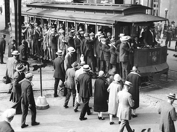People wait to get on a crowded trolley on Atlantic Ave. in