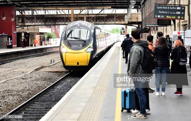 People wait to get on the Avanti West Coast train at Stoke-on-Trent Train Station on May 20, 2021 in Stoke, England. The British government has...