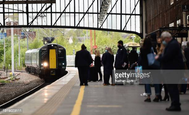 People wait to get on the Cross Country Train at Stoke-on-Trent Train Station on May 20, 2021 in Stoke, England. The British government has created a...