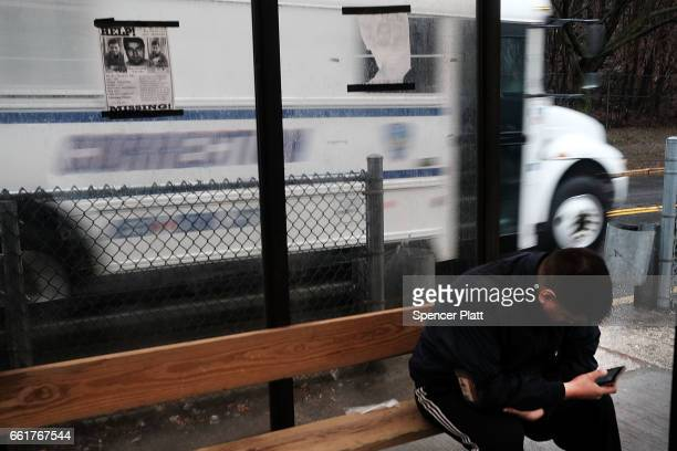 People wait to get onto a bus headed to the jail at Rikers Island on March 31 2017 in New York City New York Mayor Bill de Blasio has said that he...