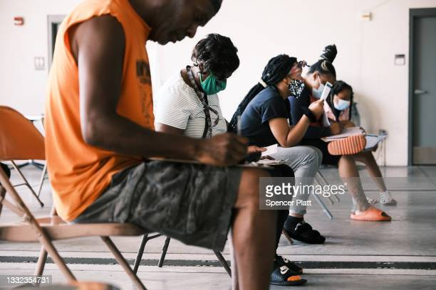 People wait to get the COVID vaccine at a clinic on August 04, 2021 in Ferguson, Missouri. According to the latest numbers from the state's health...