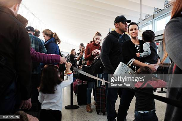 People wait to go through security at JFK Airport the day before Thanksgiving on November 25 2015 in the Queens borough of New York City One of the...