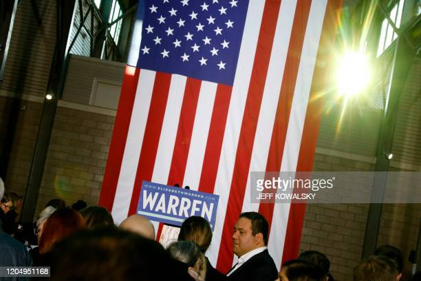 People wait to hear Democratic White House hopeful Massachusetts Senator Elizabeth Warren speak to her supporters during a campaign rally at Eastern...