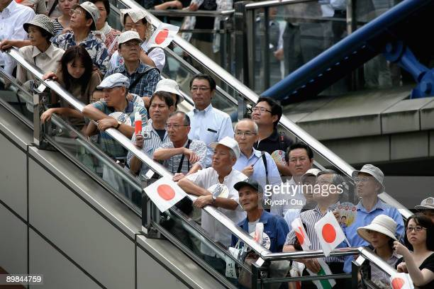 People wait to listen to a stump speech by Taro Aso Prime Minister and President of the Liberal Democratic Party during an election campaign in front...