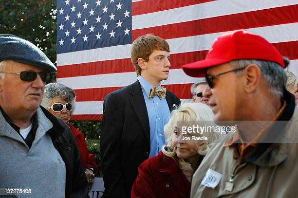 People wait to listen to Republican presidential candidate and former Massachusetts Gov Mitt Romney during a campaign rally at Wofford College on...