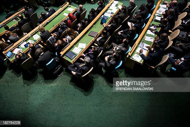 People wait to listen to US President Barack Obama speak during the general assembly of the United Nations September 25 2012 in New York New York...