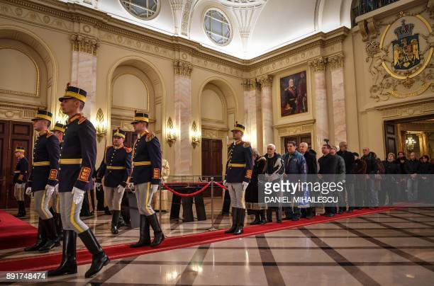 People wait to pay their respects to late King Michael I of Romania on December 13 2017 at the former Royal Palace that houses the National Arts...