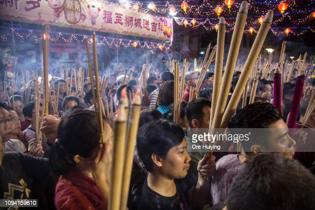 People wait to pray at a temple on the eve of the Lunar New Year of the Pig on February 4 2019 in Singapore on February 4 2019 in Singapore