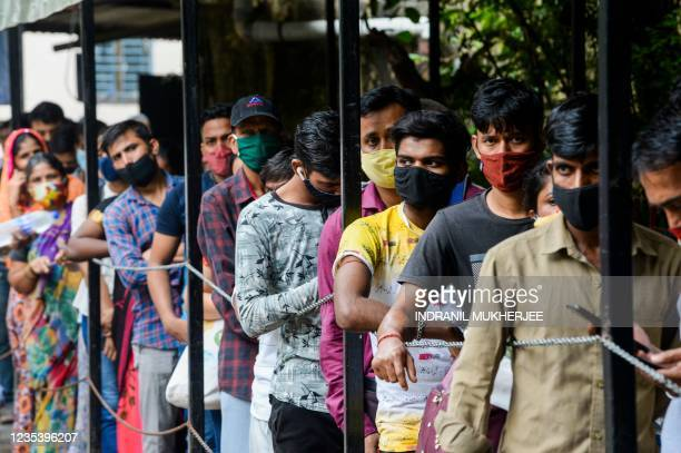 People wait to receive a Covid-19 coronavirus vaccine in a hospital in Mumbai on September 21, 2021.