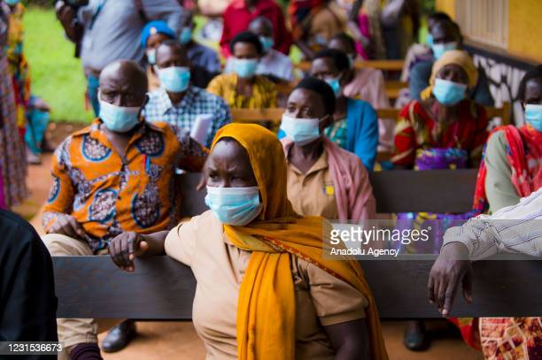 People wait to receive coronavirus vaccine as part of the vaccination campaign for health workers and people over 65 years old at Muyumba Health...