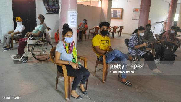People wait to receive Covid-19 vaccine, on May 30, 2021 in Chandigarh, India.