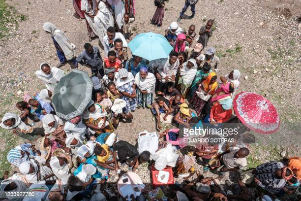 People wait to register during a food distribution organized by the Amhara government near the village of Baker, 50 kms South East of Humera, in the...