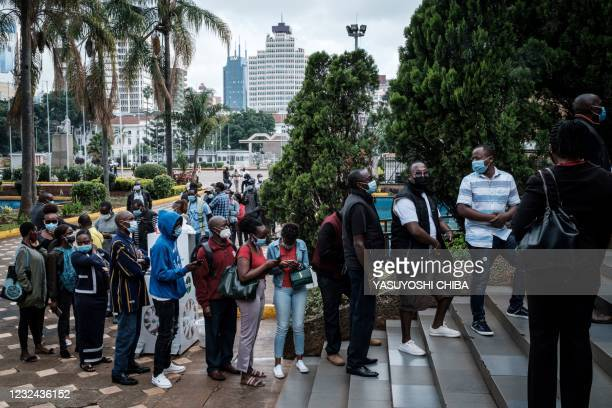 People wait to register for the first injection of the Oxford/AstraZeneca Covid-19 vaccine during the launch of the vaccination campaign for 5000...