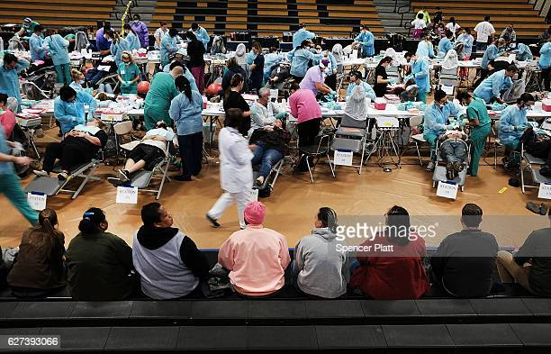 People wait to see a dentist at the Remote Area Medical mobile dental and medical clinic on December 3 2016 in Milton Florida It is expected that...