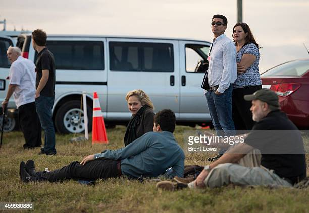 December 4: People wait to see the spacecraft Orion liftoff with the help of a Delta IV Heavy from United Launch Alliance on Thursday, December 4,...