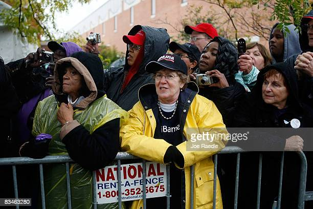 People wait to shake hands with Democratic presidential nominee US Sen Barack Obama in the rain during a campaign rally at Widener University Main...