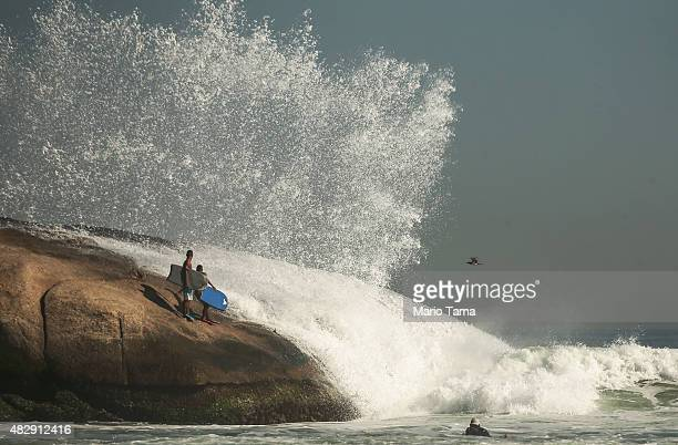 People wait to surf at Arpoador located outside Guanabara Bay on August 3 2015 in Rio de Janeiro Brazil The Rio government promised to clean 80...