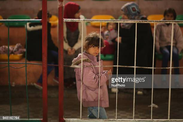 People wait to travel into Egypt after the Rafah border crossing was opened for three days for humanitarian cases in the southern Gaza Strip April 12...