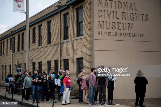 People wait to visit the National Civil Rights Museum at the site of the Lorraine Motel where Martin Luther King Jr was assassinated April 3 2018 in...