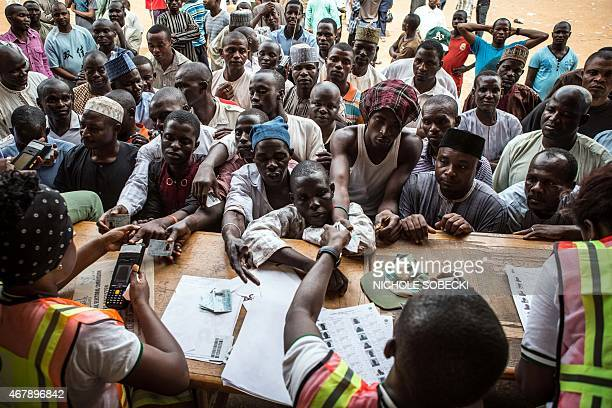 People wait to vote at a polling station in Abuja during presidential elections on March 28 2015 Problems with new technology forced a 24hour...