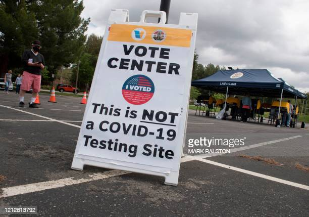 People wait to vote at a voting station for the special election between Democratic state assemblywoman Christy Smith and Republican businessman and...