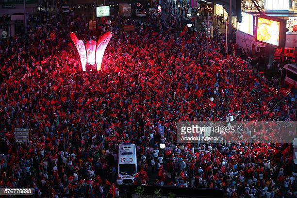 People wait Turkish President Recep Tayyip Erdogan at Kizilay square as they gather to protest the 'Parallel State/Gulenist Terrorist Organization's...