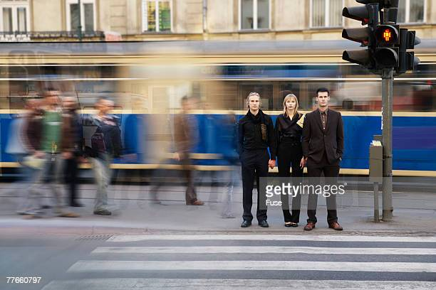 people waiting at a crosswalk - road signal stock pictures, royalty-free photos & images