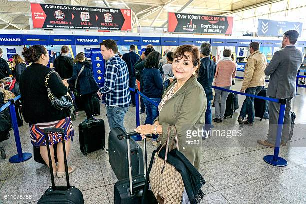 People waiting at airline check in