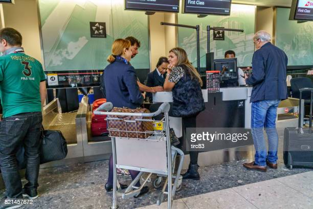 people waiting at airline check in - editorial stock pictures, royalty-free photos & images